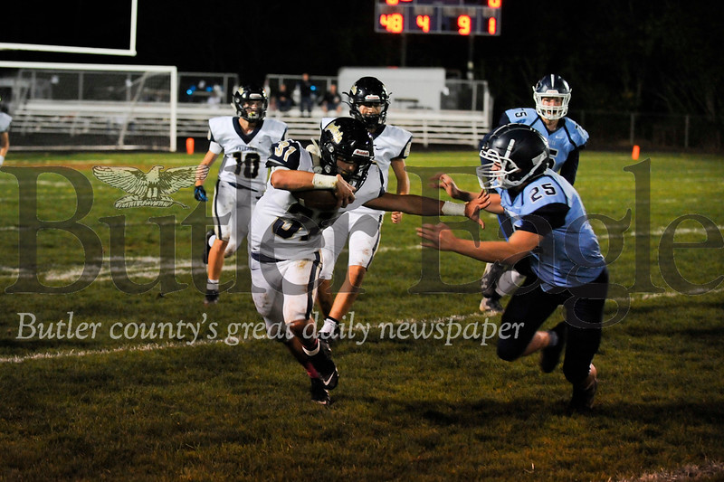 Freeport #31 Ricky unter runs the ball as Burrell #25 Josh Boak try to tackle him during a game at Burrell Stadium on Friday October 11, 2019 (Jason Swanson photo)