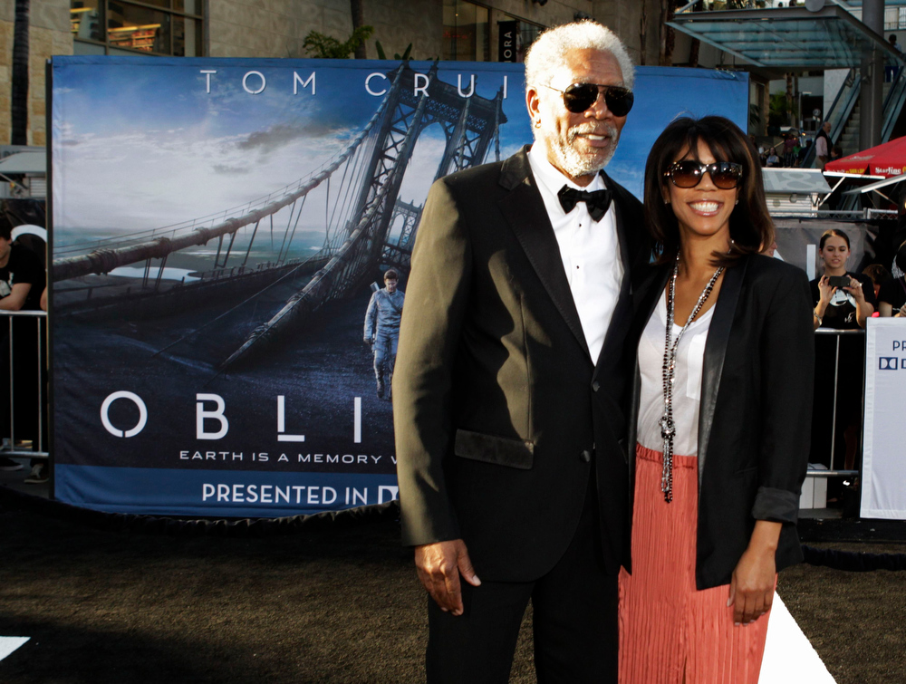 """. Actor Morgan Freeman poses at the premiere of his new film \""""Oblivion\"""" with his daughter Morgana Freeman in Hollywood April 10, 2013. REUTERS/Fred Prouser"""