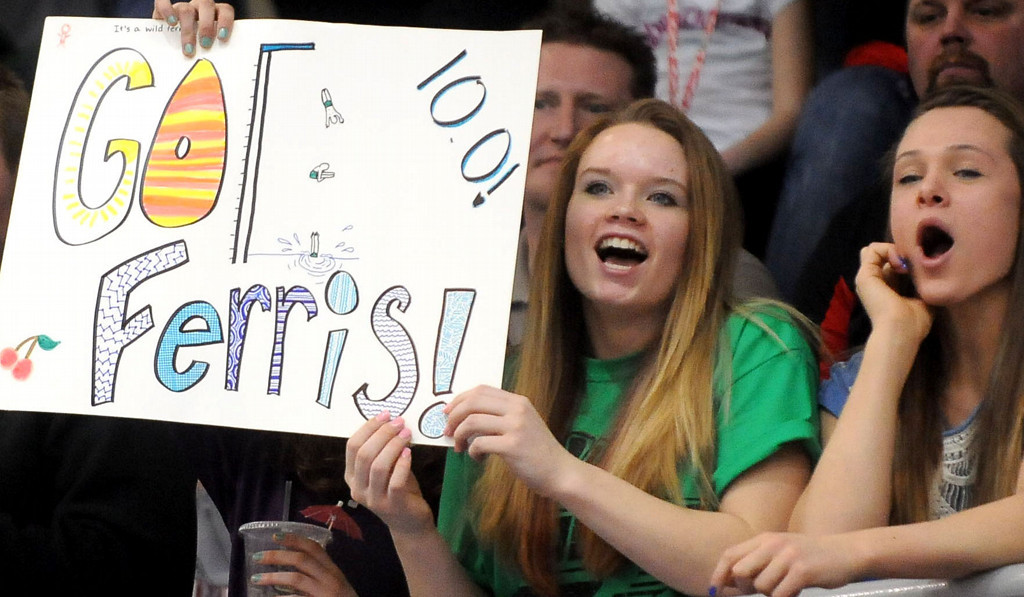 . Fans cheer for Faribault\'s Austin Ferris during the Class A State Swimming and Diving Meet. Ferris placed second in the diving competition.(Pioneer Press: Sherri LaRose-Chiglo)