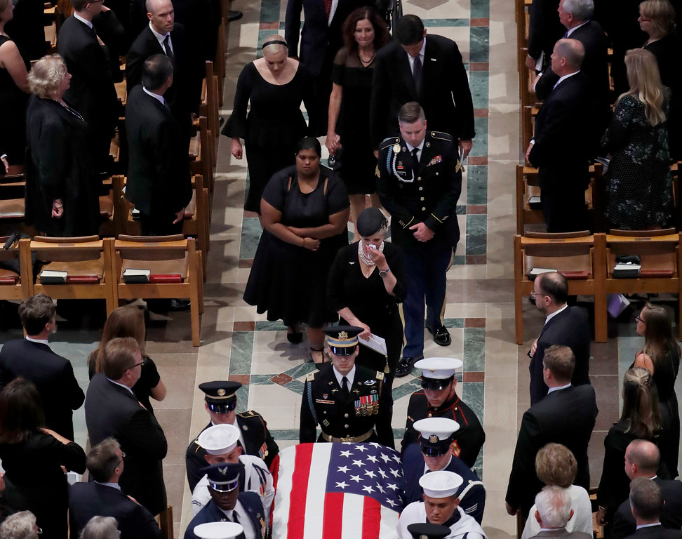 . The family of Sen. John McCain, R-Ariz., follow as the casket is carried during the recessional at the end of a memorial service at Washington National Cathedral in Washington, Saturday, Sept. 1, 2018. McCain died Aug. 25, from brain cancer at age 81. (AP Photo/Pablo Martinez Monsivais)