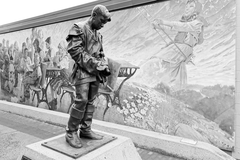 Statue and mural