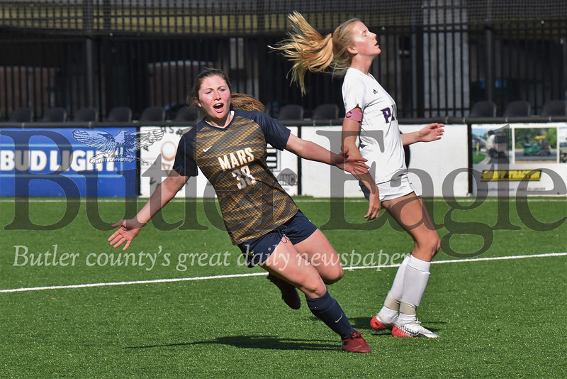 Mars' Taylor Hamlett celebrates after the second of her two first half goal in Saturday's WPIAL Class 3A Championship Saturday against Plum at Highmark Stadium in Pittsburgh. The Planets topped Plum 4-0. Seb Foltz/Butler Eagle