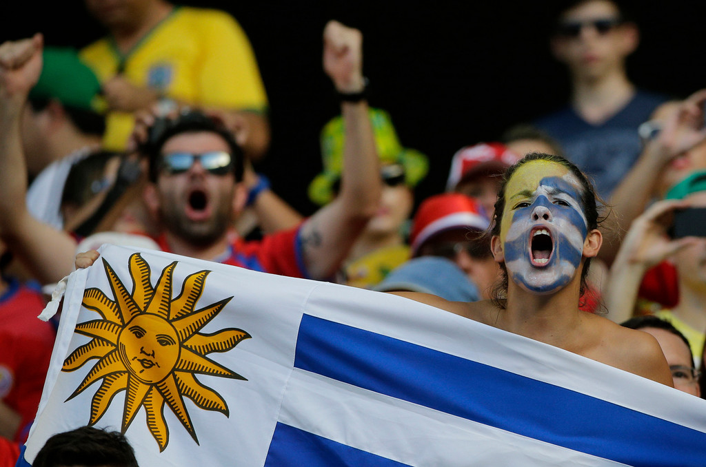 . A Uruguayan supporter cheers before the group D World Cup soccer match between Uruguay and Costa Rica at the Arena Castelao in Fortaleza, Brazil, Saturday, June 14, 2014. (AP Photo/Christophe Ena)