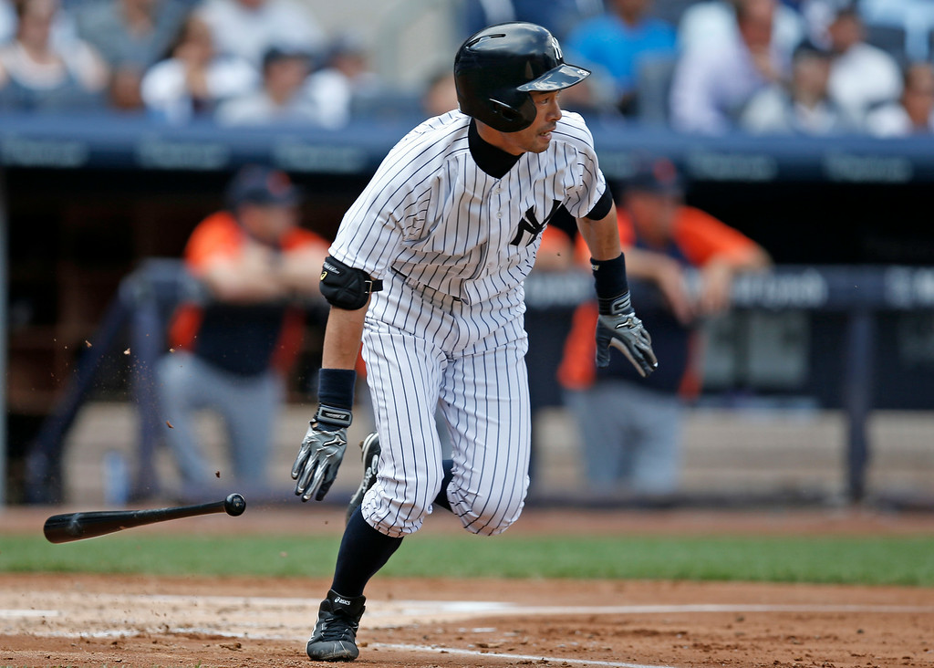 . New York Yankees Ichiro Suzuki runs on a third-inning hit in a baseball game against the Detroit Tigers at Yankee Stadium in New York, Thursday, Aug. 7, 2014.  (AP Photo/Kathy Willens)
