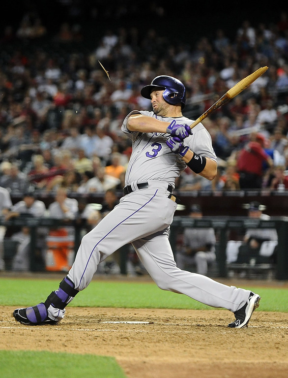 . PHOENIX, AZ - APRIL 26:  Michael Cuddyer #3 of the Colorado Rockies breaks his bat as he grounds out against the Arizona Diamondbacks in the fifth inning at Chase Field on April 26, 2013 in Phoenix, Arizona.  (Photo by Jennifer Stewart/Getty Images)
