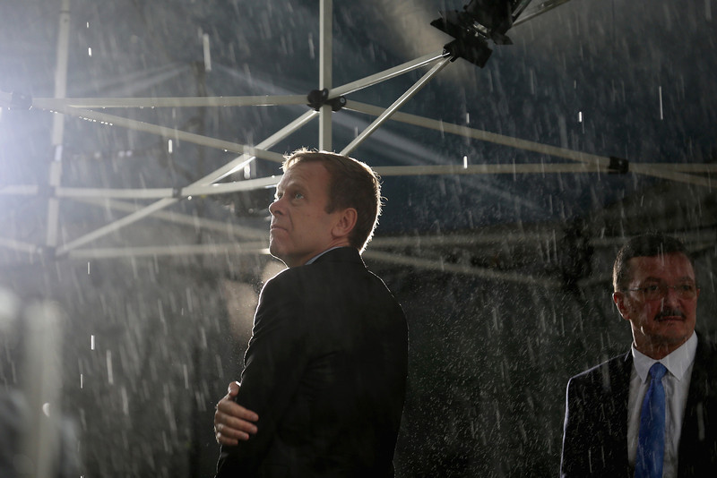 . A television presenter looks out at the torrent of rain from his makeshift studio outside North Gauteng High Court on the second day of the Oscar Pistorius trial on March 4, 2014 in Pretoria, South Africa. Olympic and Paralympic athlete Oscar Pistorius, aged 27, is accused of murdering his girlfriend Reeva Steenkamp. Pistorius denies the allegation claiming he mistook Steenkamp for an intruder inside their home on Valentines Day 2013.  (Photo by Christopher Furlong/Getty Images)