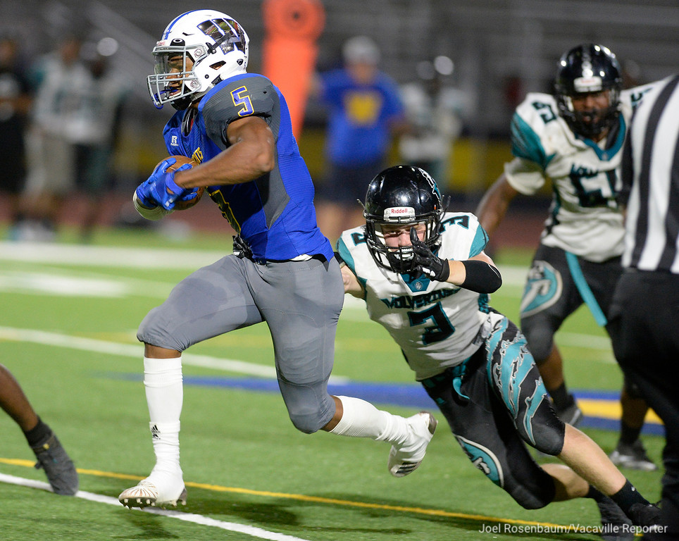 . Wood running back, Adonis Dennis sprints past Deer Valley linebacker, Logan Fontaine for a big gain during the fourth quarter of the Wildcats 20-8 victory Friday at Wildcat Stadium.