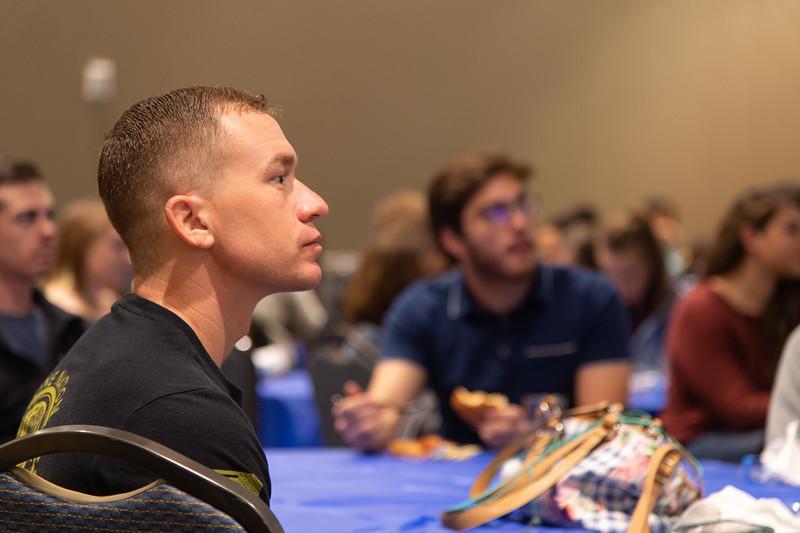Kelly Cadena (left) listens to the international speakers.