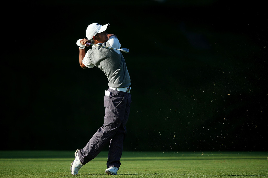 . Amateur Cheng-Tsung Pan of Chinese Taipei hits his second shot on the tenth hole during the continuation of Round Two of the 113th U.S. Open at Merion Golf Club on June 15, 2013 in Ardmore, Pennsylvania.  (Photo by Andrew Redington/Getty Images)