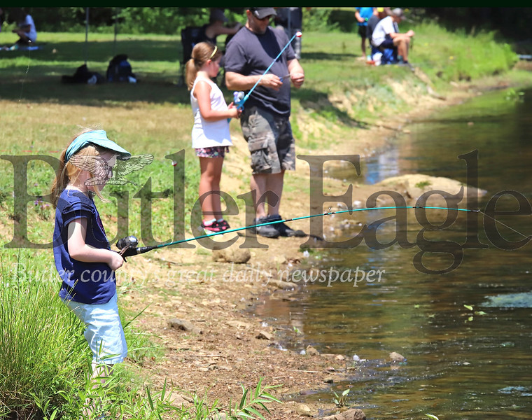 Abby Reeves, 6, of Butler waits for a fish to bite on her line during Concordia's Kids Fishing Days Saturday at Saxony Farm Estates. Seb Foltz/Butler Eagle 07/26/20