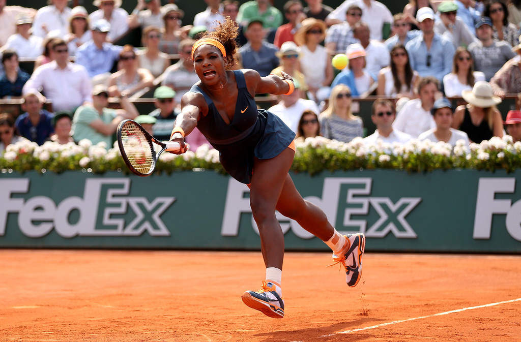 . Serena Williams of United States of America stretches to play a forehand in her Women\'s Singles Final match against Maria Sharapova of Russia  during day fourteen of French Open at Roland Garros on June 8, 2013 in Paris, France.  (Photo by Clive Brunskill/Getty Images)
