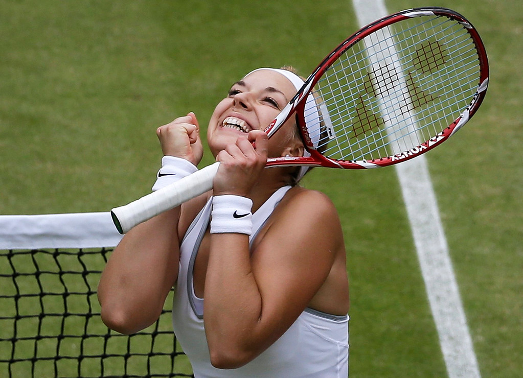 . Sabine Lisicki of Germany reacts as she wins a Women\'s singles quarterfinal match against Kaia Kanepi of Estonia at the All England Lawn Tennis Championships in Wimbledon, London, Tuesday, July 2, 2013. (AP Photo/Anja Niedringhaus)