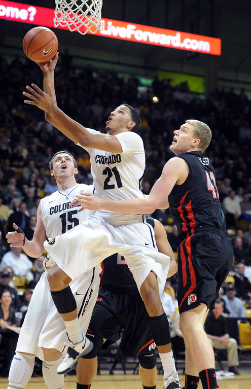 . Andre Roberson of Colorado drives to the basket past Jeremy Olson of Utah during the first half of the February 21st, 2013 game in Boulder. For more photos of the game, go to www.dailycamera.com. Cliff Grassmick / February 21, 2013