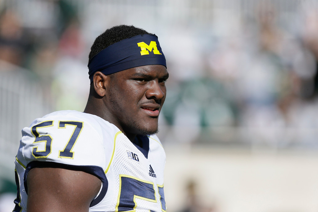 . Michigan  defensive end Frank Clark (57) is seen before the first half of an NCAA college football game against Michigan State in East Lansing, Mich., Saturday, Oct. 25, 2014. (AP Photo/Carlos Osorio)