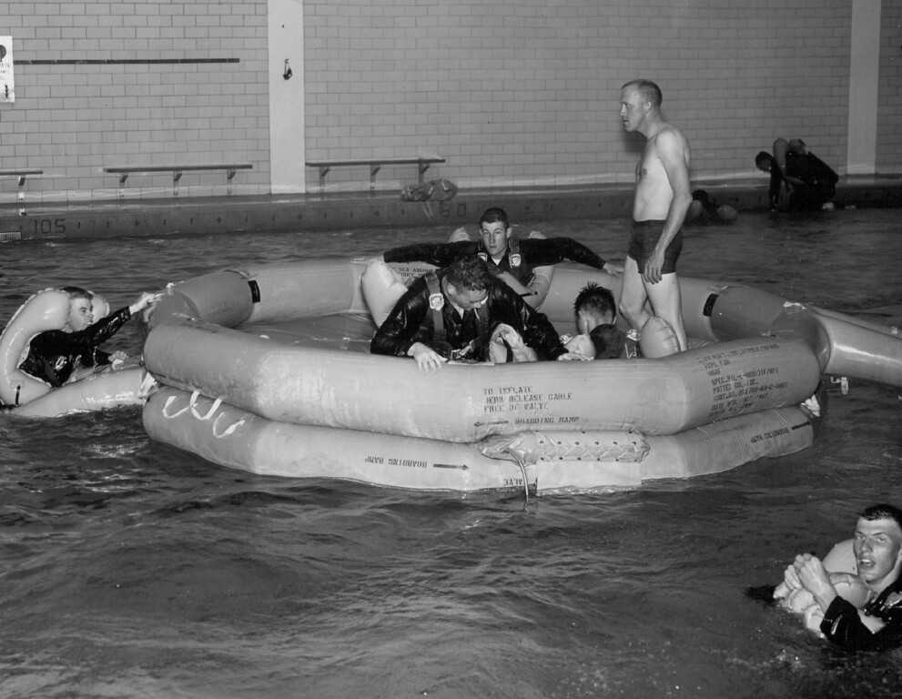 . Air Force ROTC Cadets receive training in water survival in the Air Force Academy swimming pool where some 200 cadets from around the state are spending a month acquiring skills they will need as air crewmen and officer. 1969. The Denver Post Library Archive