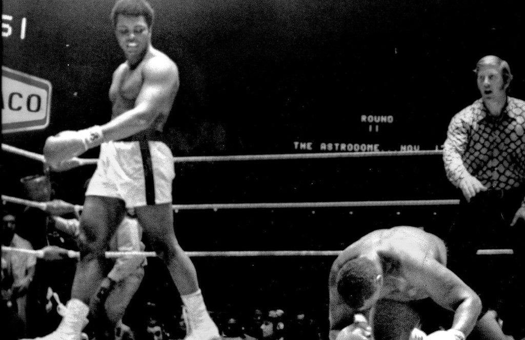 . Muhammad Ali grimaces as ken Norton connects with a left the chin during their 12-round heavyweight bout at the sports arena in San Diego , Calif. Ali lost on a split decision. 1971. Denver Post Library photo archive