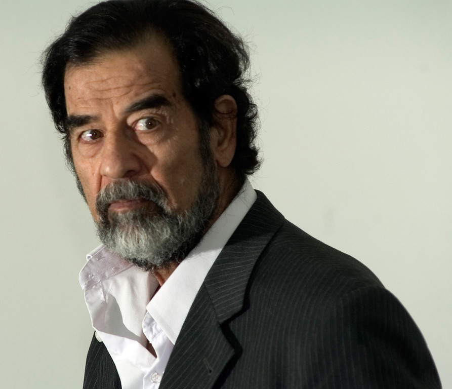 . In this photo released by the Iraqi Special Tribunal, former Iraqi leader Saddam Hussein is seen as he is questioned by Chief Investigative Judge Raid Juhi, not seen, in this Aug. 23, 2005, photo at an unknown location.  (AP Photo/Iraqi Special Tribunial, Pool)