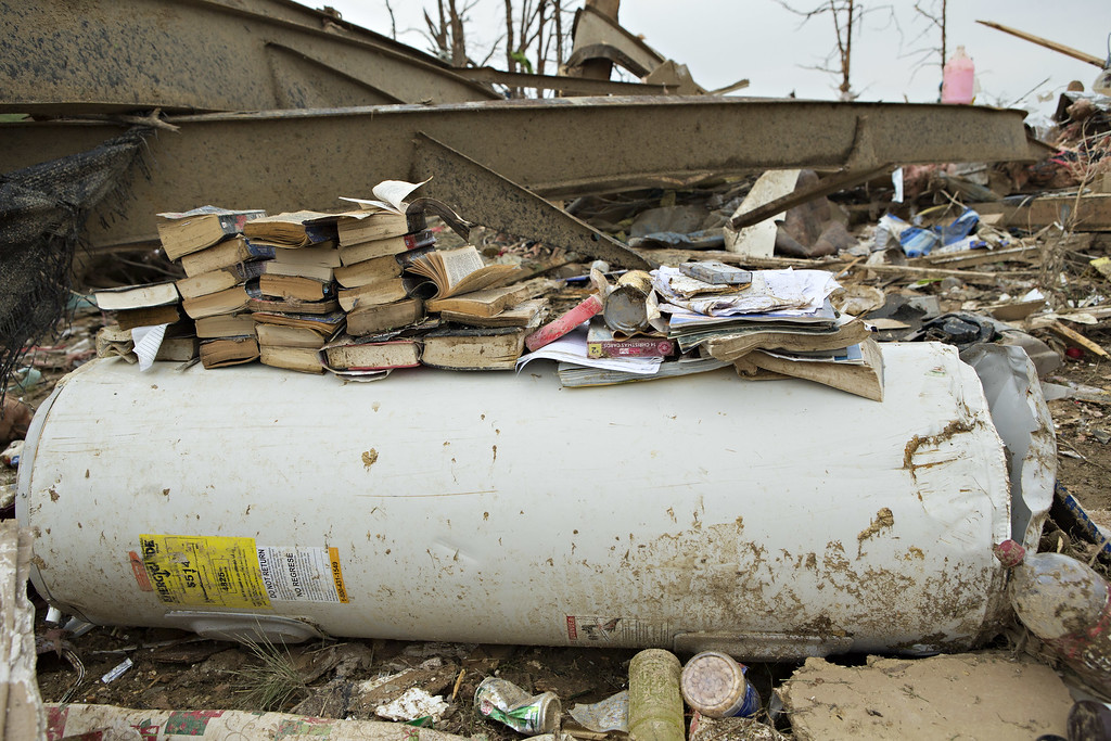 . Books are stacked on a water heater after a strong tornado went through the area on April 27 for the second time in three years on April 28, 2014 in Vilonia, Arkansas. After deadly tornadoes ripped through the area and have left over a dozen dead, Mississippi, Arkansas, Texas, Louisiana, and Tennessee are all under watch as multiple storms over the next few days are expected.  (Photo by Wesley Hitt/Getty Images)