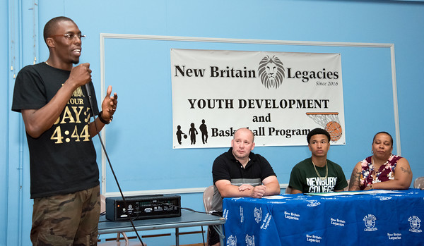 05/25/18 Wesley Bunnell | Staff Founder of New Britain Legacies Basetball Deivone Tanksley speaks to the attendees at the signing of Francisco Santiago II from E.C. Goodwin High School on Friday night to attend and play basketball for Newbury College. Parents Francisco Santiago Sr and Marsha Michaud sit on either side of him.