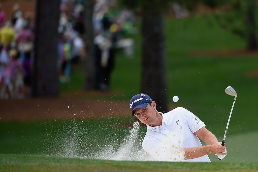 . Justin Rose of England plays a bunker shot on the seventh hole during the final round of the 2014 Masters Tournament at Augusta National Golf Club on April 13, 2014 in Augusta, Georgia.  (Photo by Harry How/Getty Images)