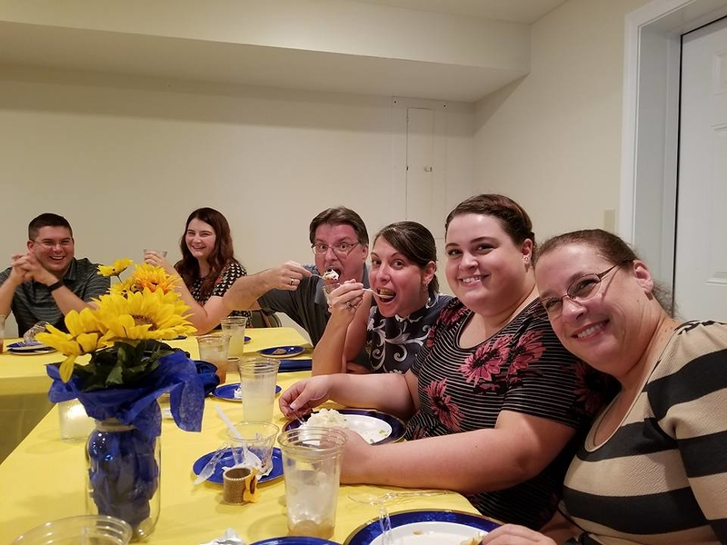 Eating at the rehearsal dinner.