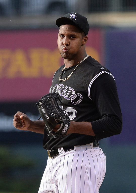 . Colorado starter Juan Nicasio reacted on the mound after giving up a grand slam home run in the first inning to Atlanta batter Andrelton Simmons. The Colorado Rockies hosted the Atlanta Braves Tuesday night, June 10, 2014. (Photo by Karl Gehring/The Denver Post)
