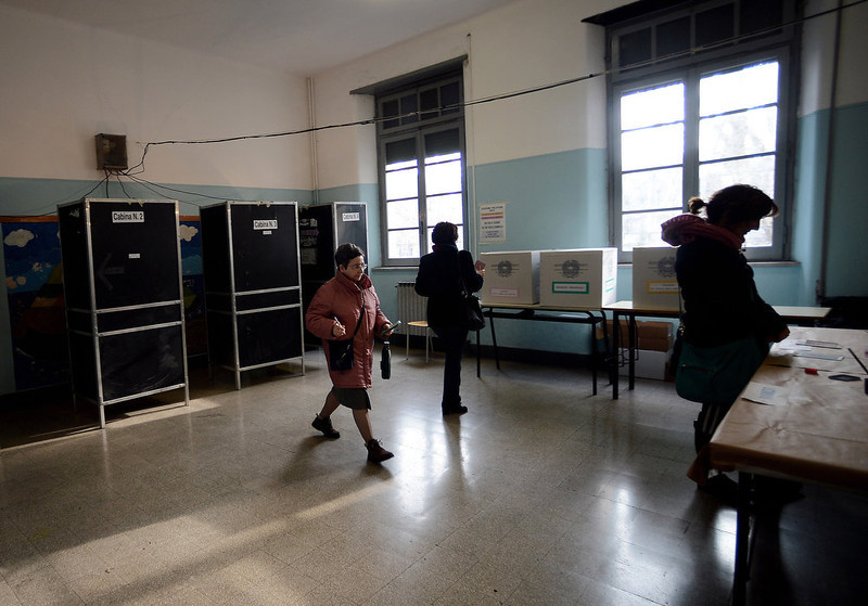 . People walk in a polling station in Rome on February 24, 2013 during Italy\'s general elections. Italians fed up with austerity voted in the country\'s most important election in a generation, as Europe held its breath for signs of fresh instability in the eurozone\'s third economy.  FILIPPO MONTEFORTE/AFP/Getty Images