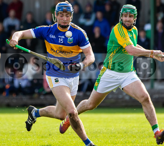 Kiladangan's Billy Seymour heading for goal watched on by Toomevara's Joey McLoughney in the Tipperary Senior Hurling Quarter final in Cloughjordan