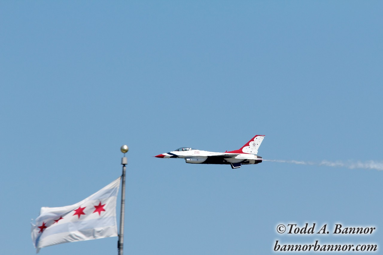 U.S. Air Force Thunderbirds F16 Fighting Falcon. Thunderbird 6 and the Chicago city flag.