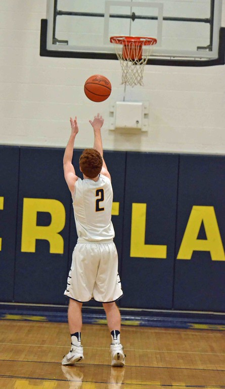 . Paul DiCicco - The News-Herald Kirtland�s Palmer Capretta attempts a free throw early in the first quarter.