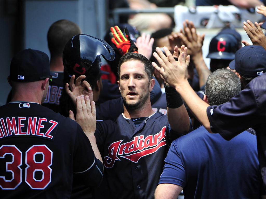 . Cleveland Indians\' Yan Gomes, center, is greeted by teammates after scoring against the Chicago White Sox during the second inning of a baseball game, Wednesday, May 25, 2016, in Chicago. (AP Photo/David Banks)