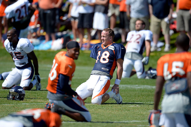 . Denver Broncos QB Peyton Manning (18) stretches during training camp August 12, 2013 at Dove Valley. (Photo By John Leyba/The Denver Post)