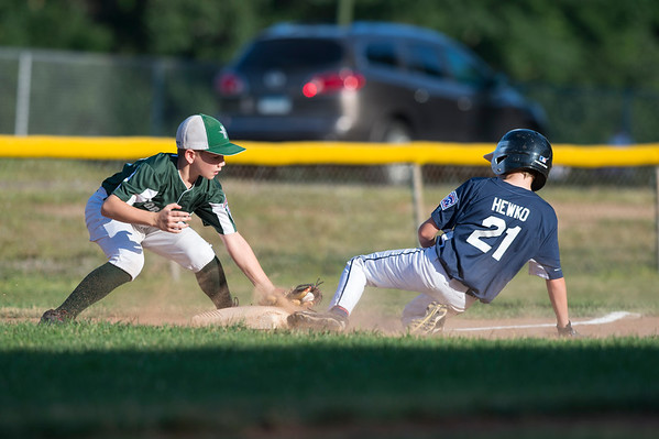 07/08/19 Wesley Bunnell | Staff Forrestville vs Southington North Little League baseball at Recreation Park in Southington on Monday July 8, 2019. Southington's Christian Hewko (21) slides into third base as TJ Maldonado (29) attempts the tag.