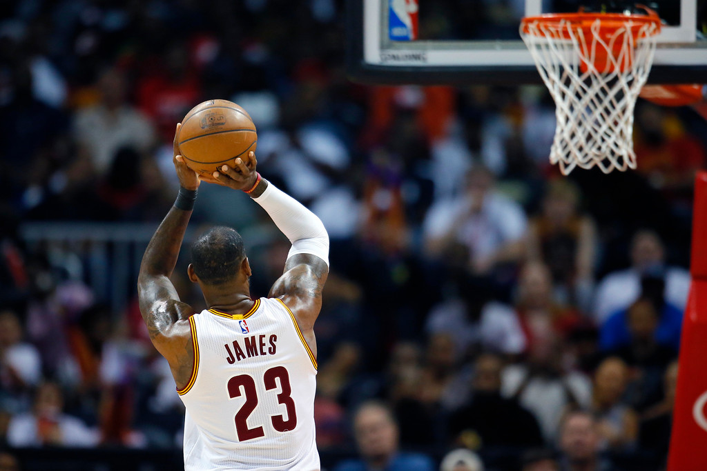 . Cleveland Cavaliers forward LeBron James (23) shoots from the line in the first half of an NBA basketball game against the Atlanta Hawks, Sunday, April 9, 2017, in Atlanta. (AP Photo/Todd Kirkland)