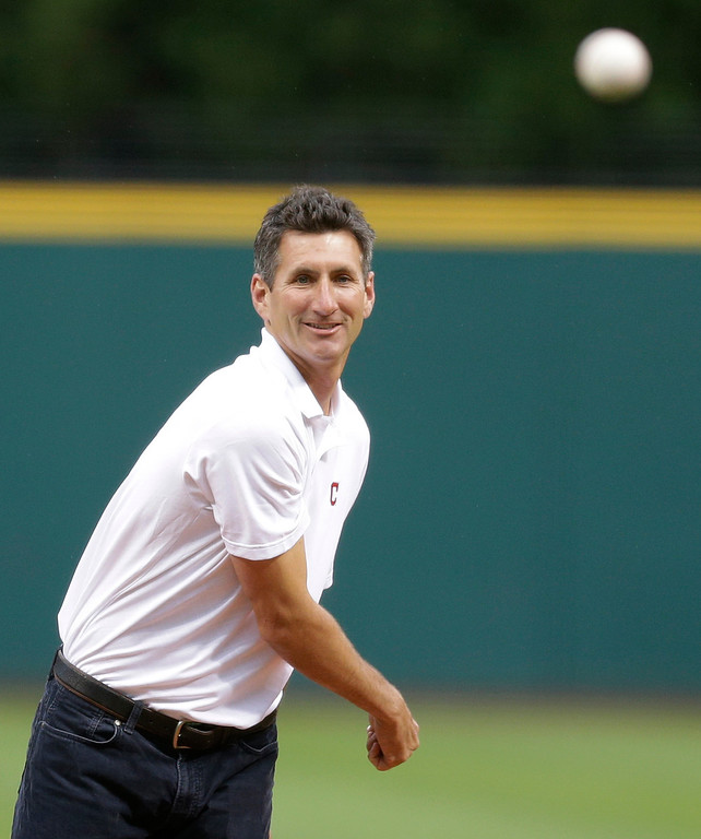 . Former Cleveland Indians pitcher Charles Nagy throws out the ceremonial first pitch before a baseball game between the Detroit Tigers and the Indians, Friday, June 20, 2014, in Cleveland. (AP Photo/Tony Dejak)