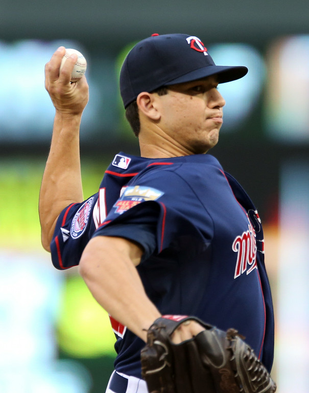 . Minnesota Twins starting pitcher Tommy Milone throws against the Detroit Tigers in the first inning of a baseball game, Friday, Aug. 22, 2014, in Minneapolis. (AP Photo/Jim Mone)