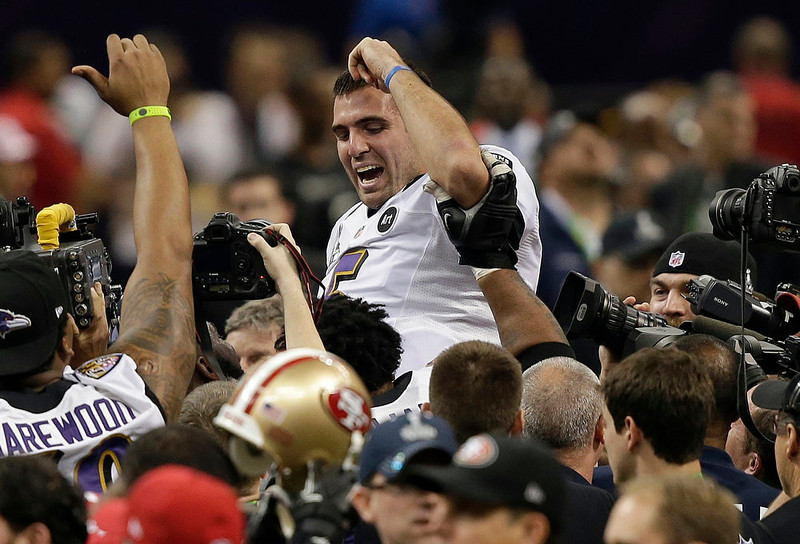 . Baltimore Ravens quarterback Joe Flacco is lifted into the air by teammates after defeating the San Francisco 49ers 34-31 in the NFL Super Bowl XLVII football game in New Orleans on Feb. 3, 2013.   (AP Photo/Bill Haber, File)