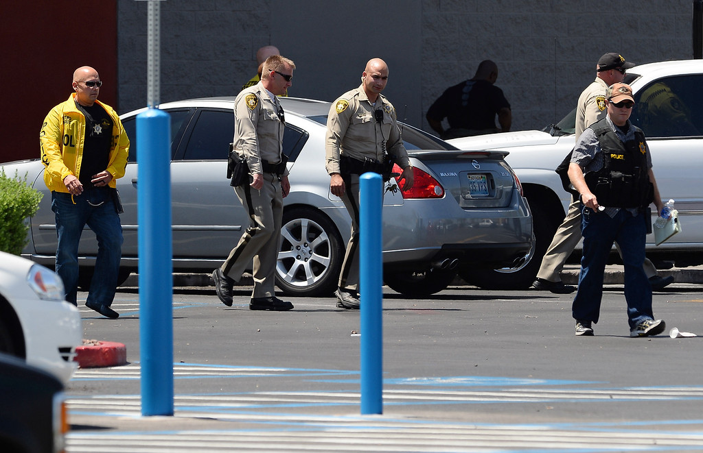 . Las Vegas Metropolitan Police Department officers walk outside a Wal-Mart on June 8, 2014 in Las Vegas, Nevada.  (Photo by Ethan Miller/Getty Images)