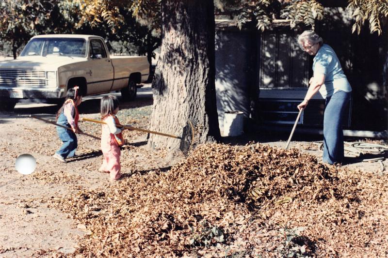 Alaya, Josh, Frankie raking pecan leaves. Oct 1985