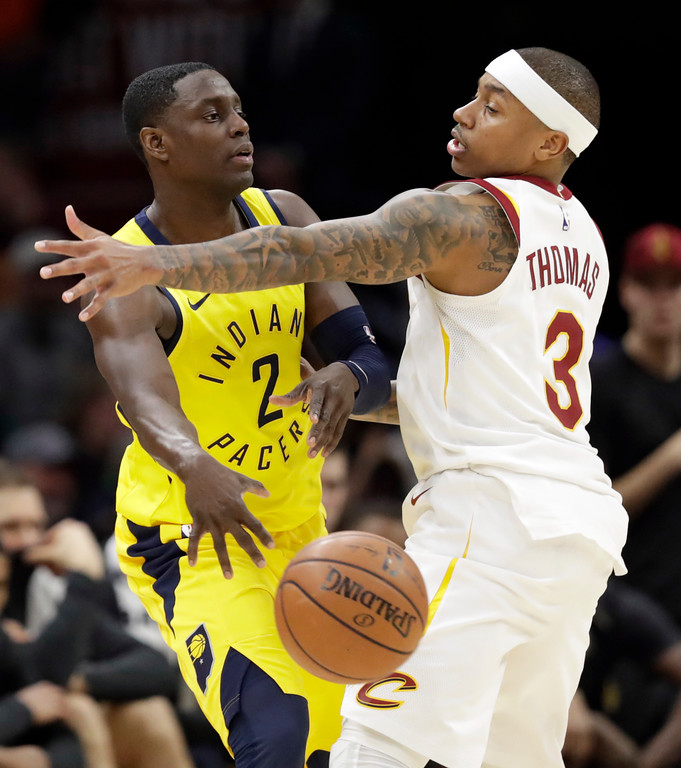 . Indiana Pacers\' Darren Collison (2) passes against Cleveland Cavaliers\' Isaiah Thomas (3) in the first half of an NBA basketball game, Friday, Jan. 26, 2018, in Cleveland. (AP Photo/Tony Dejak)