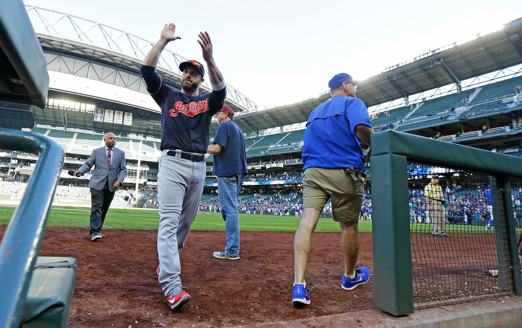 . Cleveland Indians outfielder Jason Kipnis applauds fans after a TV interview following a baseball game against the Seattle Mariners, Sunday, Sept. 24, 2017, in Seattle. The Indians won 4-2. (AP Photo/Ted S. Warren)