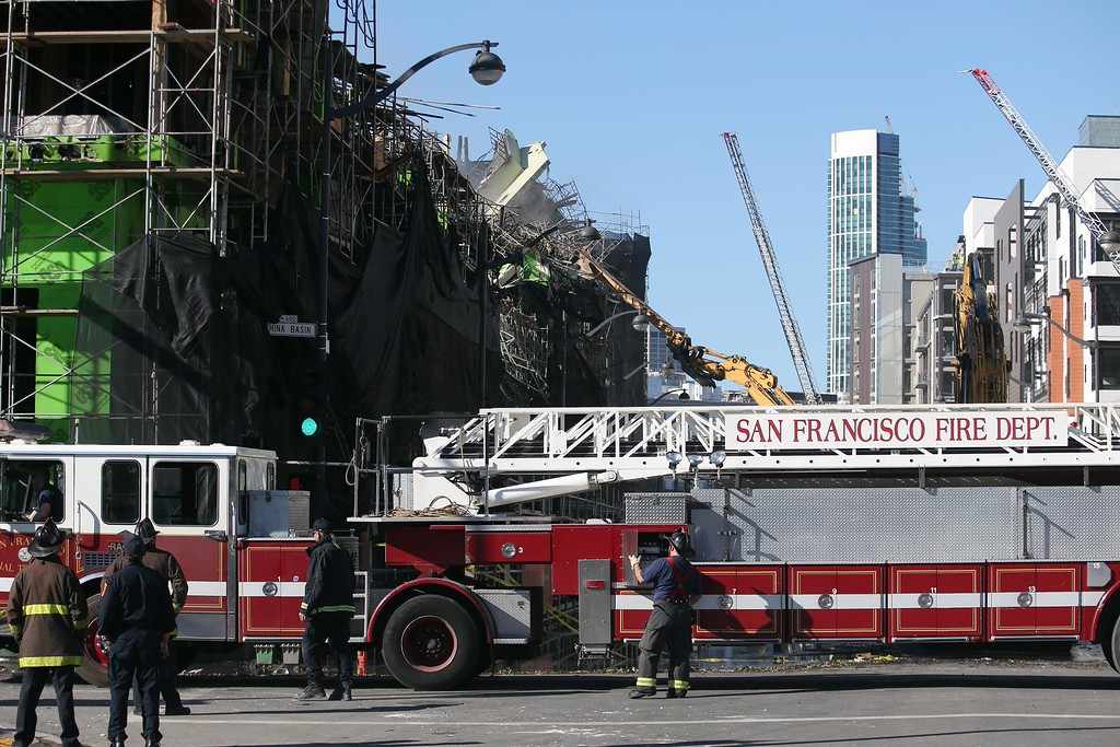 . Crews begin demolition of an apartment complex on Fourth Street in the Mission Bay neighborhood of San Francisco, Calif., on Wednesday, March 12, 2014. Firefighters remained on scene as the remains of the $227 million project were still smoldering after being destroyed by a massive 5-alarm blaze on Tuesday. (Jane Tyska/Bay Area News Group)
