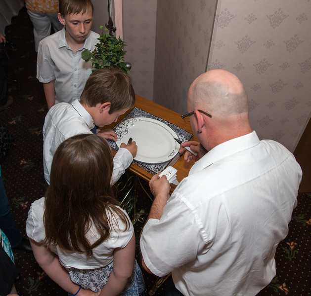 Signing the plate.jpg