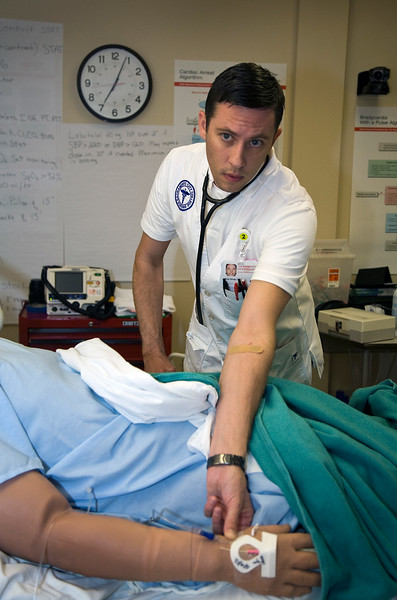 SCC/EX nursing student Brian Bangs checks the pulse of a simulated patient during an exercise at the SCC/EX campus simulation lab.