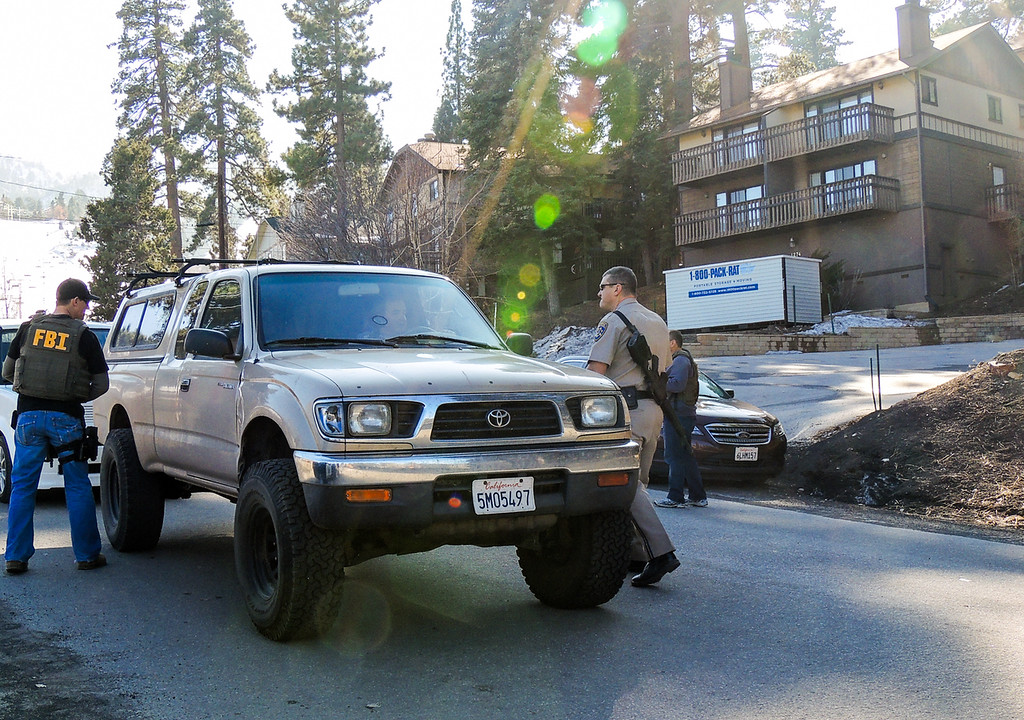 . Authorities evacuate Bear Mountain Resort as the manhunt for fugitive ex-LAPD officer Christopher Jordan Dorner in Big Bear on Thursday, Feb. 7, 2013. Dorner\'s burned out Nissan truck was found near the resort. On Feb. 12, the manhunt came to fiery end, and Dorner allegedly hid in a condo resort, seen in this photograph, where authorities first evacuated Bear Mountain Resort, and held their command post.  (Rachel Luna / Staff Photographer)