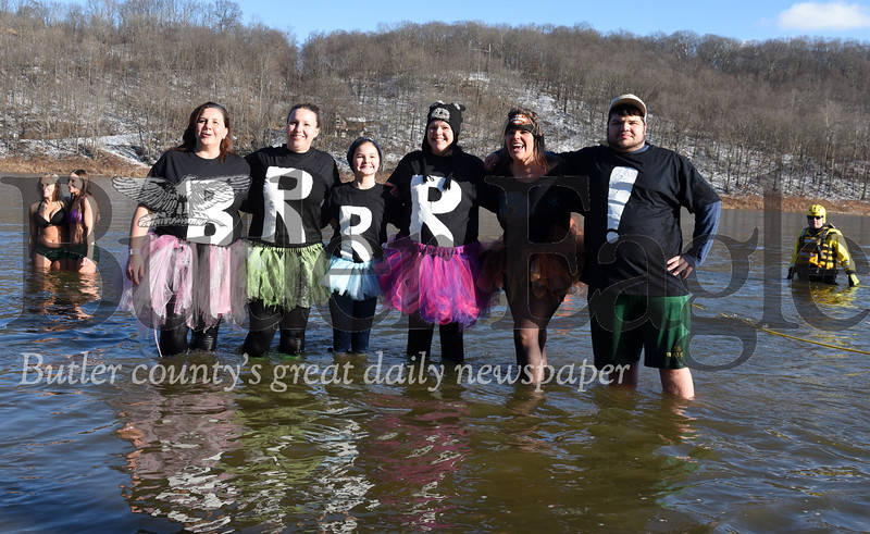 Harold Aughton/Butler Eagle: (left - right) Spelling Brrr! Janie Montgomery, of Rimersburg; Amber Colwell of New Bethlem; Madison and Tannya Darwin of Clarion, Kathy Bailey of Sigel, and McCoy Teague of Clarion  took park in the annual Parker Polar Bear Plunge in the Allegheny River, Wednesday, January 1, 2020.