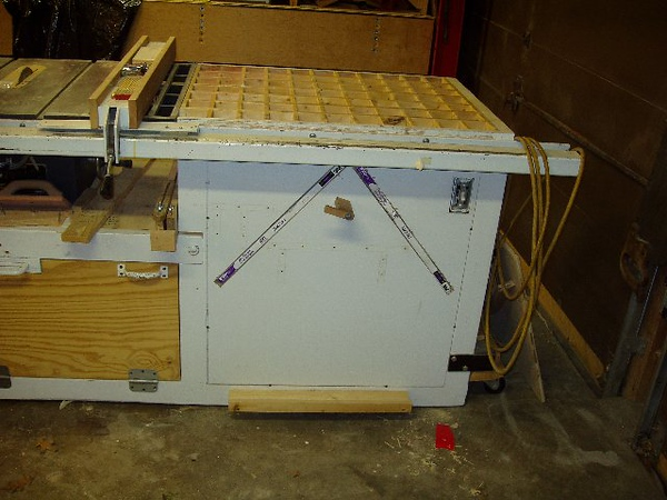 "The air cleaner is part of the table saw's 54"" extension table.   It also is my down draft sanding table."