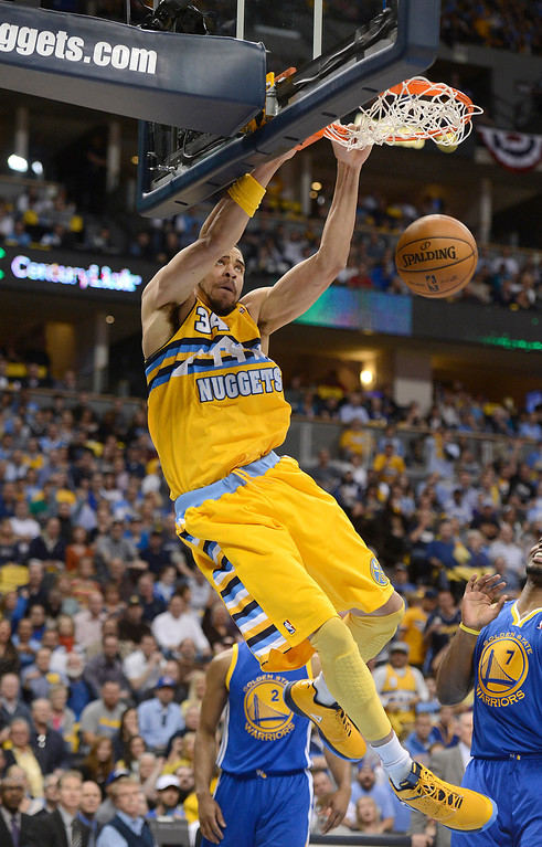 . DENVER, CO. - APRIL 20: Denver Nuggets center JaVale McGee (34) dunks the ball in the first quarter. The Denver Nuggets took on the Golden State Warriors in Game 1 of the Western Conference First Round Series at the Pepsi Center in Denver, Colo. on April 20, 2013. (Photo by John Leyba/The Denver Post)