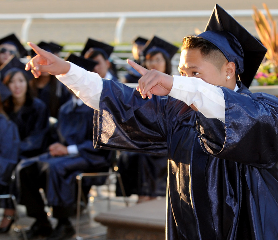 . Nikko Angelo Delavin walking to obtain his diploma. Gabrielino High in San Gabriel School Class of 2014 graduation was held at Santa Anita Park in Arcadia Wednesday, June 4, 2014.Photo by Walt Mancini/Pasadena Star-News)