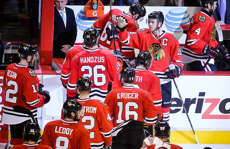 . Chicago Blackhawks center Jonathan Toews greets his teammates as they come of the ice after they beat Minnesota Wild 2-1 in Game 5 of the second round of the Stanley Cup Playoffs at United Center in Chicago, IL., on Sunday, May 11, 2014. (Pioneer Press: Ben Garvin)